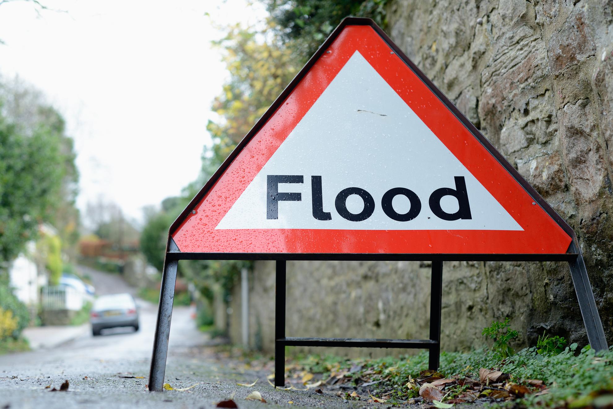 flood risk warning sign in rural road